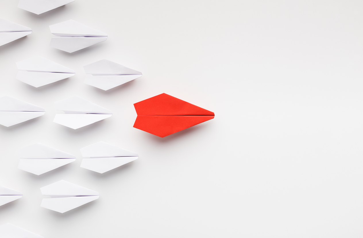 Red paper plane leading another ones, leadership concept