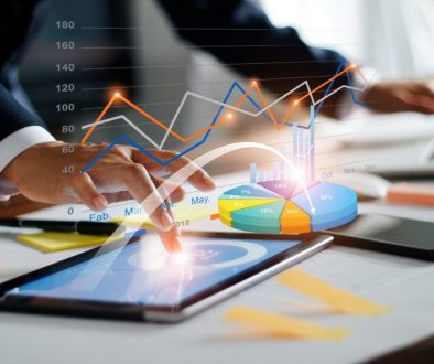 Businessman using tablet and laptop analyzing sales data and economic growth graph chart. Business strategy. Digital marketing. Business innovation technology concept